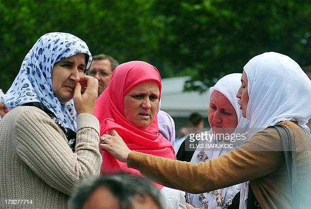 Bosnian Muslim woman Hava Muhic survivor of Srebrenica 1995 massacre observes burial of the body of her child the youngest victim during a mass...