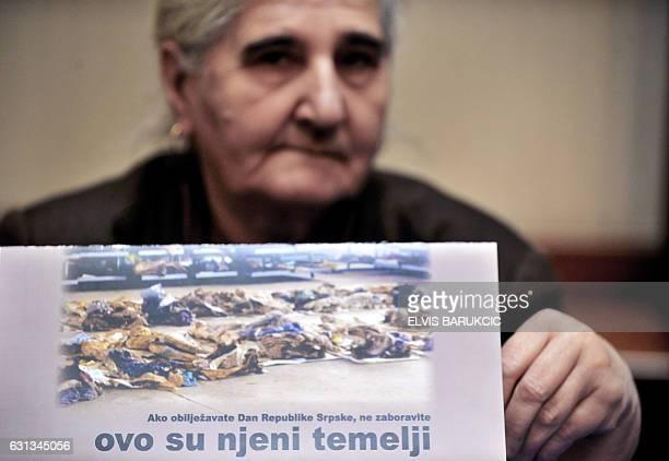 Bosnian Muslim woman Munira Subasic survivor of 1995 massacre in Srebrenica holds up a publication showing excavated remains of the Srebrenica...