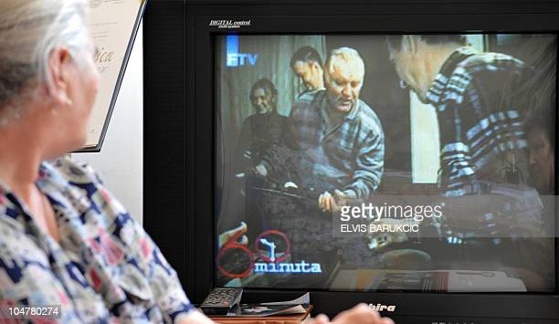 Bosnian Muslim woman Munira Subasic survivor of Srebrenica genocide in 1995 watches a video of warcrime fugitive Ratko Mladic broadcasted by Bosnian...
