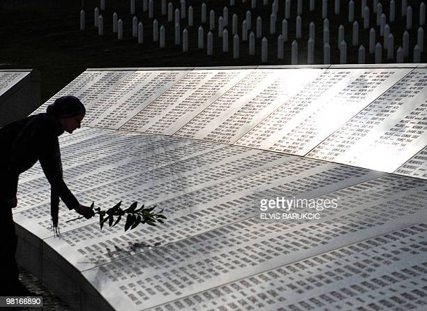 A Bosnian Muslim woman survivor of Srebrenica atrocities in 1995 Sehida Abdurahmanovic arrives at Potocari memorial cemetery near Srebrenica on March...