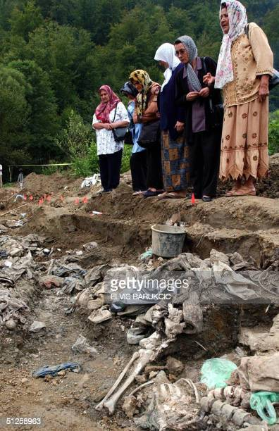 Bosnian Muslim women from Srebrenica eastern Bosnia stand on the edge of a mass grave site discovered in the nearby village of Bljeceva in hope to...