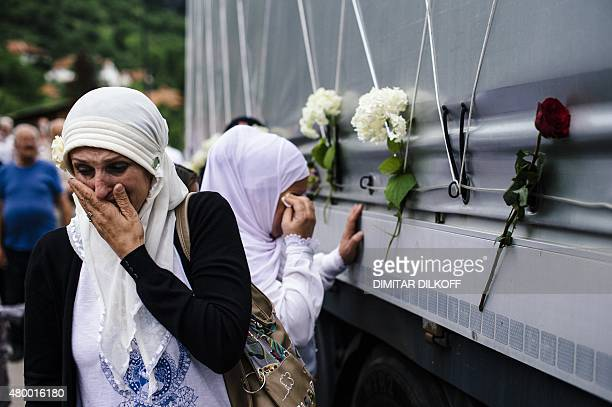 Bosnian muslim women reacts as they touch a truck carrying 136 coffins of newly identified victims of the 1995 Srebrenica massacre in the town of...