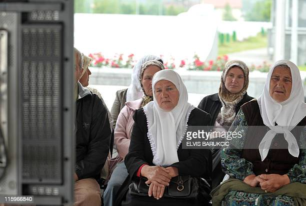 Bosnian Muslim women survivors of the Srebrenica massacre watch the live broadcast of Ratko Mladic's appearance before the International Criminal...