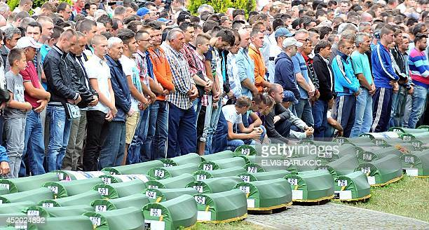 Bosnian Muslims family members and survivors of the Srebrenica 1995 massacre attend the burial ceremony at a memorial cemetery in Potocarion near...
