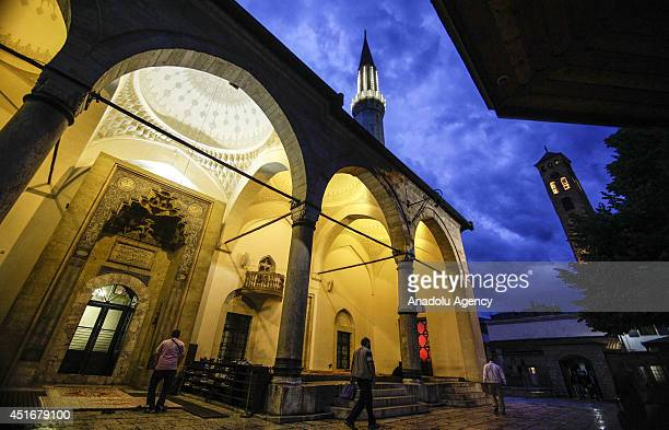 Bosnian Muslims go to mosques for praying in Sarajevo Bosnia and Herzegovina on July 4 2014 Signs of Ottoman and Turkish culture can still be seen in...
