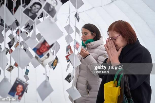 Bosnian Muslims pray inside a makeshift memorial for Bosnian Muslim victims on November 22 2017 in The Hague The Netherlands The International...