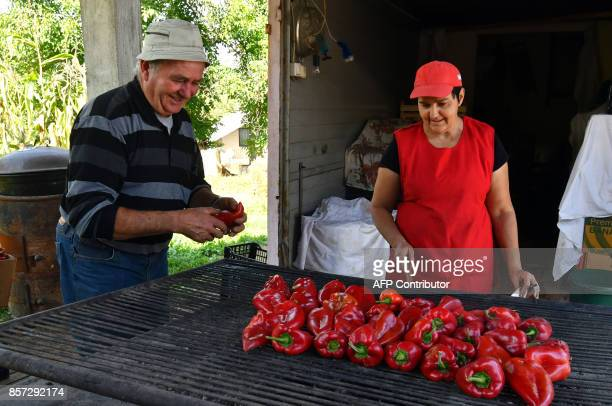BRIEN Bosnian people bake red peppers to prepare ajvar on September 24 in Ljetovik near the CentralBosnian town of Kiseljak It's a source of Balkan...