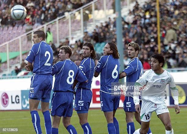 Bosnian players from L to R Vladan Grujic Nedim Halilovic Ninoslav Milenvovic Ivica Grlic Emir Spahic and Iran's Arash Borhani look at the ball after...