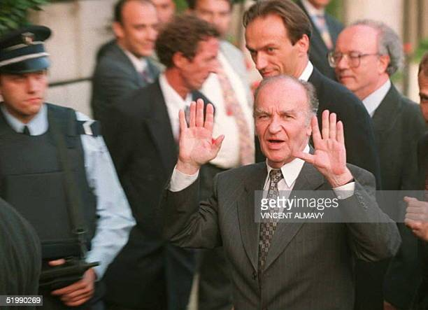Bosnian President Alija Izetbegovic gestures to photographers 28 August as he arrives at the Hotel Crillon in Paris Izetbegovic arrived for talks...