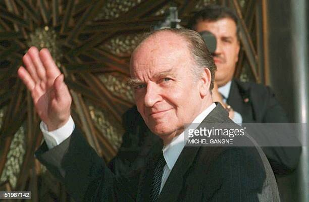 Bosnian President Alija Izetbegovic waves to journalists as he arrives at the royal palace in Casablanca 14 December for the second day of the 7th...