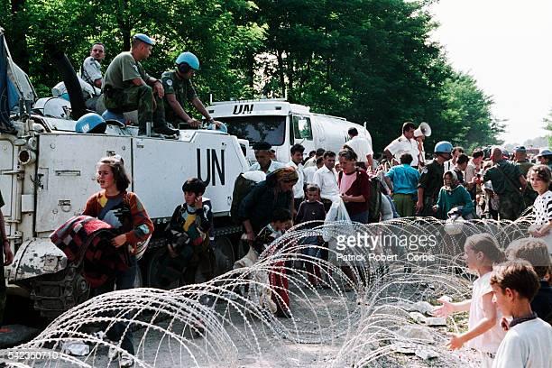 Bosnian refugees from Srebrenica arrive at the Tuzla refugee camp