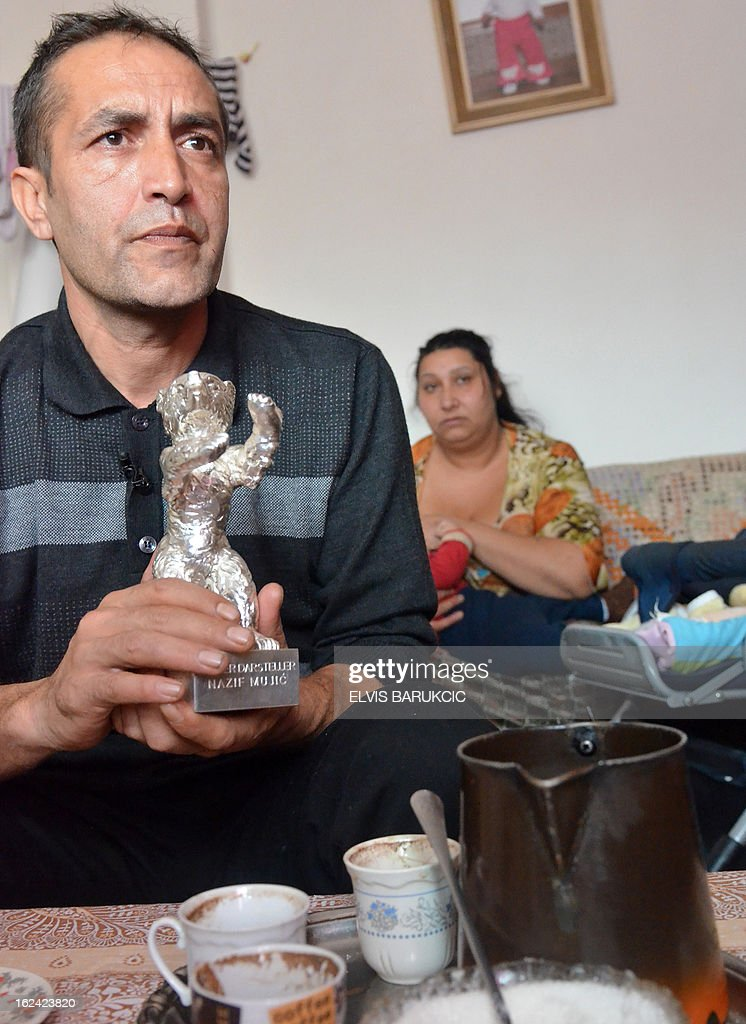 Bosnian Roma, Nazif Mujic (42) and his wife Senada (30) sit in their home in village of Svatovac, on February 20, 2013. Earlier this month, Mujic picked up the Silver Bear prize for best actor at the Berlin Film Festival. His performance in Bosnian director Danis Tanovic's 'An Episode in the Life of an Iron Picker' was one of the highlights of the festival.