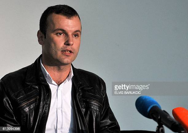 Bosnian Serb candidate for mayor Mladen Grujicic addresses a press conference late on October 2 after the first preliminary results of the local...