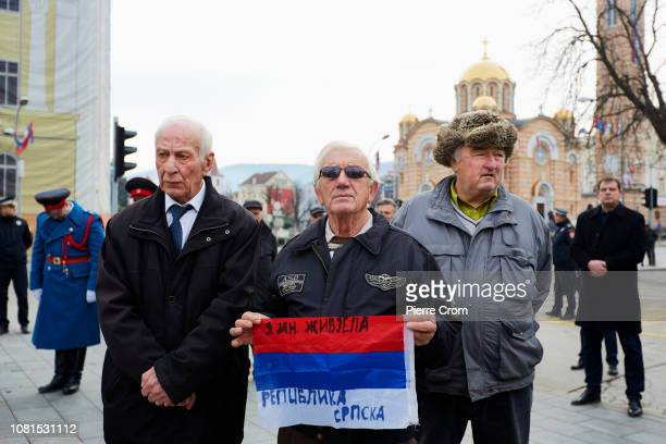 Bosnian Serb man holds a flag with the text long live Republika Srpska during a ceremony on January 8 2019 in Banja Luka Bosnia and Herzegovina...