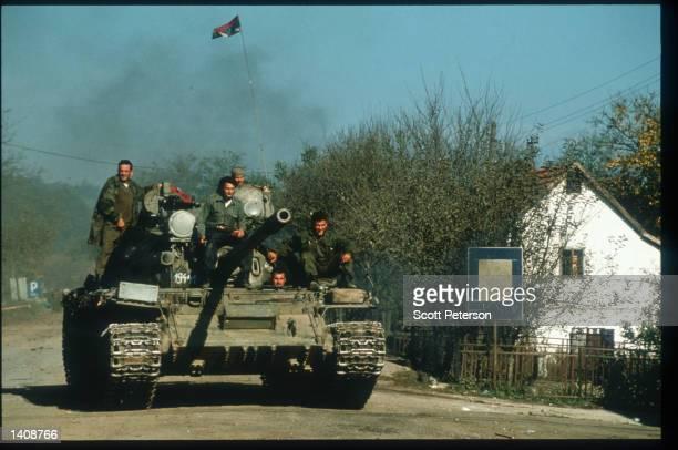 Bosnian Serb tank drives along a road near Ostra Luka October 20 1995 in Omarska Bosnia and Herzegovina Over 25000 Serb refugees who fled Croatian...