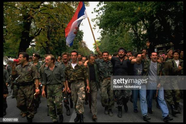 Bosnian Serb troops marching w flag protesting conditions on battle home fronts in mutiny by 1000 veteran civil war 1st Krajina Corp troops