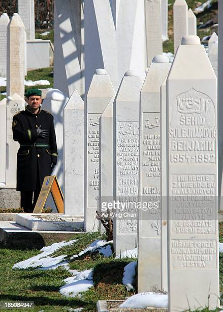 Bosnian soldier paying respect to the dead at the Sarajevo war memorial and cemetery. The Siege of Sarajevo between 1992 and 1996 lasted for almost 3...