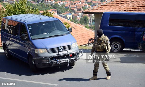Bosnian Special Police Forces officer secures the perimeter during an arrest operation in Sarajevo on August 30 2017 Bosnian police have arrested one...