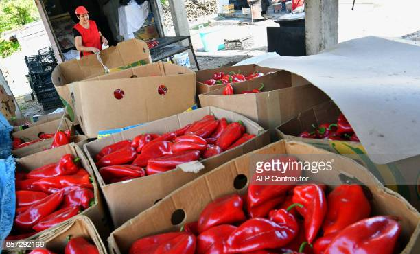 BRIEN A Bosnian woman bakes red peppers to prepare ajvar on September 24 in Ljetovik near the CentralBosnian town of Kiseljak It's a source of Balkan...