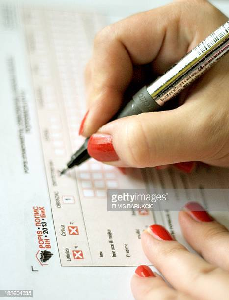 A Bosnian woman fills in forms for the latest census in Sarajevo on October 1 2013 Census in Bosnia and Herzegovina was last conducted in 1991 The...