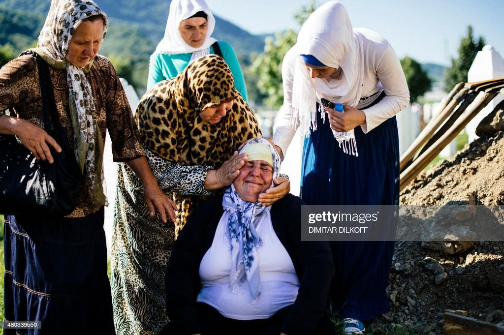 A Bosnian woman mourns at the freshly dug grave of her brother on July 11, 2015 at the Potocari Memorial Center near the eastern Bosnian town of Srebrenica, where 136 bodies found in mass grave sites in eastern Bosnia will be reburied on 20th anniversary of the Srebrenica massacre. Thousands of people were pouring into Srebrenica today to commemorate the 20th anniversary of the massacre of thousands of Muslims in the worst mass killing in Europe since World War II. The remains of 136 newly-identified victims were to be laid to rest alongside more than 6,000 others already buried at a memorial centre just outside the eastern Bosnian town.