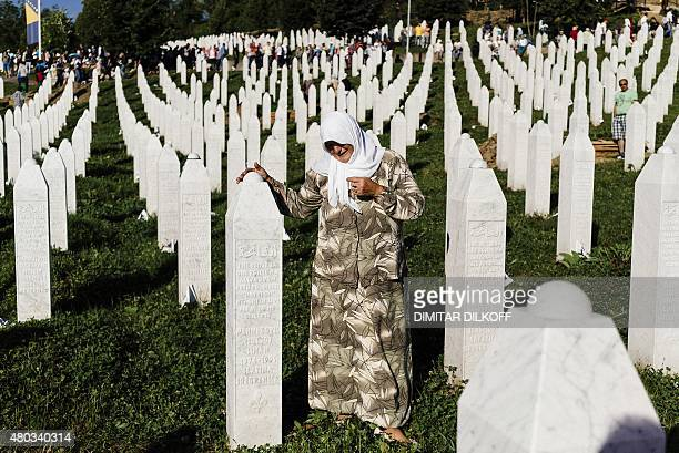 A Bosnian woman mourns at the grave of a relative on July 11 2015 at the Potocari Memorial Center near the eastern Bosnian town of Srebrenica where...