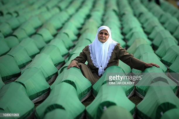 A Bosnian woman mourns over coffins of a newly identified victim of the 1995 Srebrenica massacre during preparation for mass burial at the Potocari...