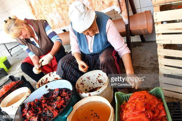BRIEN A Bosnian woman peel roasted red peppers to prepare ajvar on September 24 in Ljetovik near the CentralBosnian town of Kiseljak It's a source of...