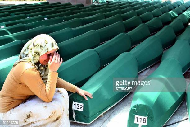 Bosnian woman weeps next to the coffins of Muslim men and boys before their burial in Potocari near Srebrenica East Bosnia and Herzegovina 11 July...