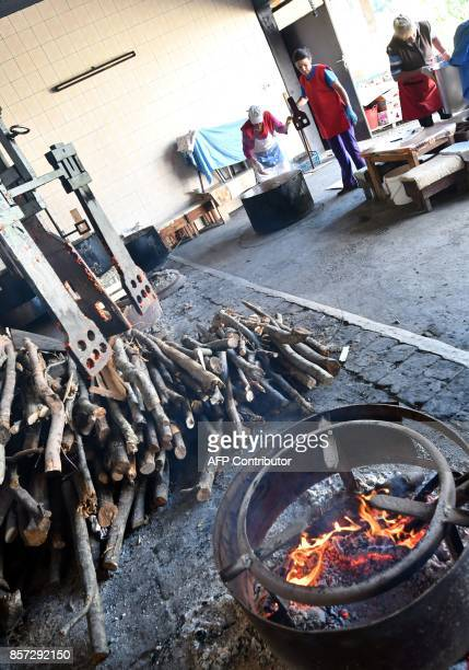 BRIEN Bosnian women bakes red peppers to prepare ajvar on September 24 in Ljetovik near the CentralBosnian town of Kiseljak It's a source of Balkan...