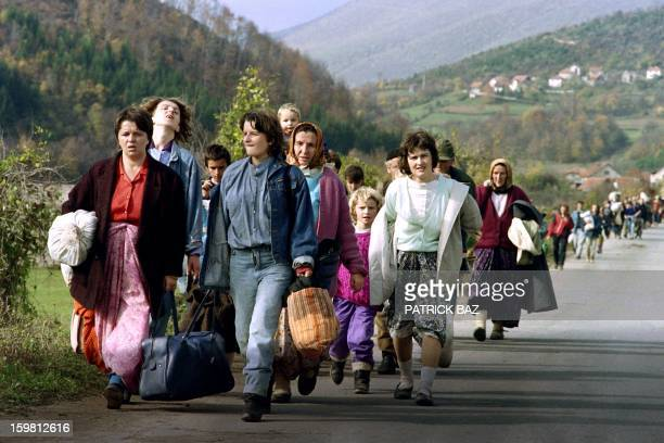 Bosnian women carrying their belongings flee Jajce on October 31 1992 Some 10 000 refugees gathered on the roads leading to Travnik fleeing the town...