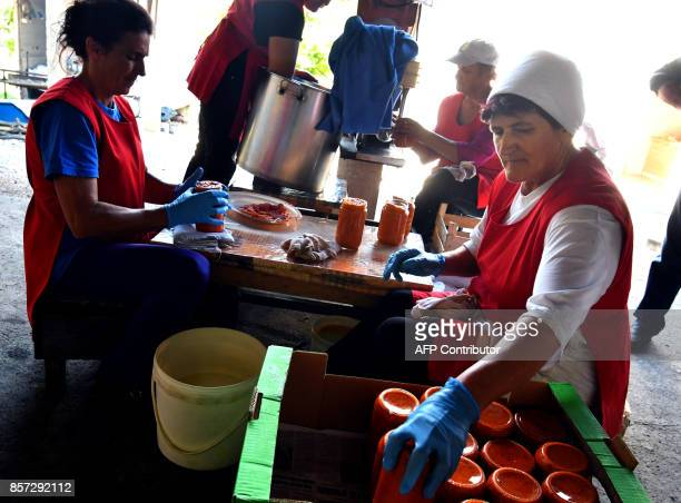 BRIEN Bosnian women pack freshly cooked ajvar into glass jars on September 24 in Ljetovik near the CentralBosnian town of Kiseljak It's a source of...