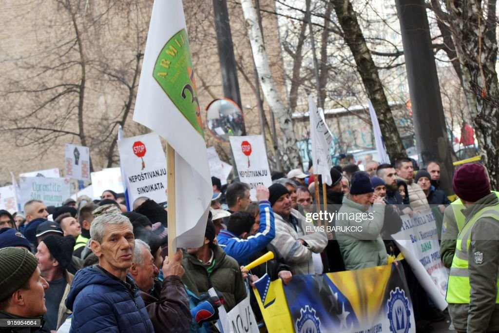 Bosnian workers of several state owned or partially state owned companies, hold placards as they demonstrate in front of the government building in Sarajevo, on January 24, 2018 to protest against the privatisation process of the companies where they work. After Bosnia's war in the 1990s, business gradually went downhill like at many state-run firms hit by both the transition to a market economy for which they were not equipped, and mismanagement. According to trade unions, between 50,000 and 65,000 former or current employees of mostly state companies, such as hospitals, mines or public transport, will not get their pension, as the companies had not been paying into the state pension fund. Tax authorities estimate that unpaid social contributions amount to almost two billion euros, or half of Bosnia's annual national budget. /