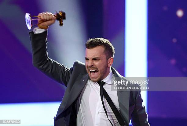 Bosnianborn German actor Edin Hasanowic receives the Golden Camera award for Best new actor in Hamburg northern Germany on February 6 2016 / AFP /...