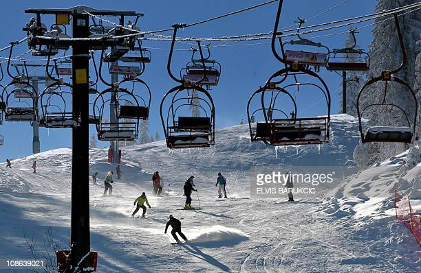 Bosnians and tourists ski down Mount Jahorina 30 kms south of Sarajevo on January 25 2011 Presence of fresh snow mild winter temperatures and lower...