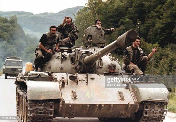 BosnianSerb soldiers flash the threefingered Serbian ultranationalist sign from atop a T55 tank This unit was moving within the UNNATO heavyweapons...