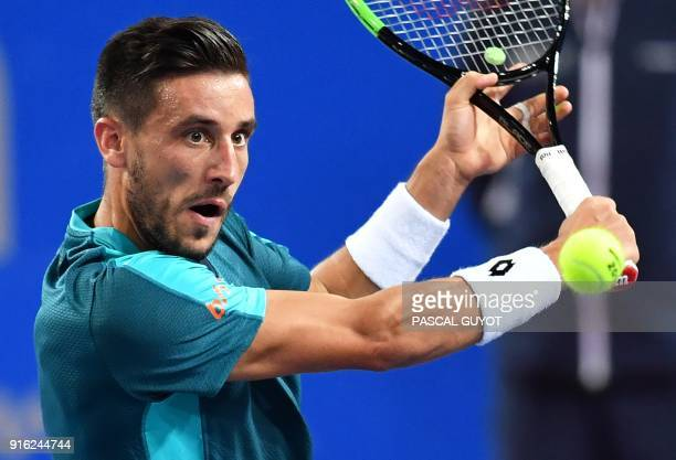Bosnia's Damir Dzumhur returns the ball to France's Richard Gasquet during their quarterfinal singles tennis match at the Open Sud de France ATP...