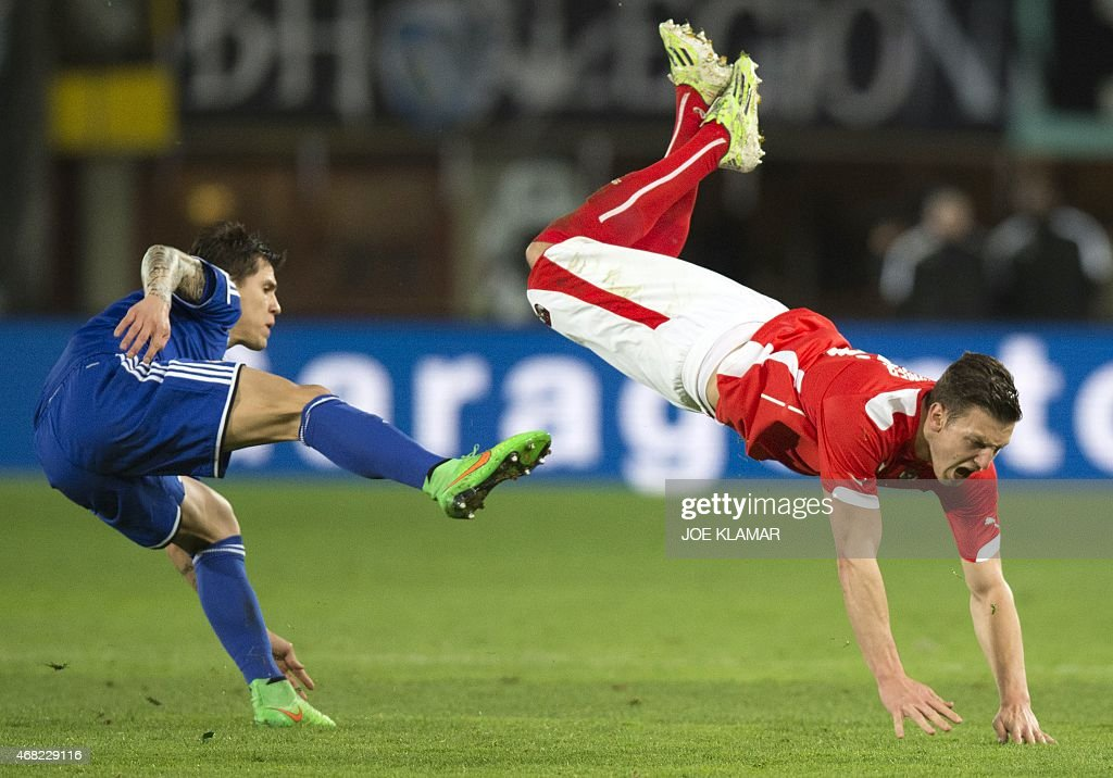 Bosnia's Muhamed Besic Fouls Austria's Kevin Wimmer During