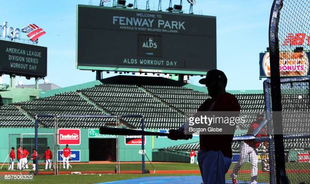 Boson Red Sox second baseman Dustin Pedroia waits for his turn in the batting cage during a practice session at Fenway Park in Boston as the team...