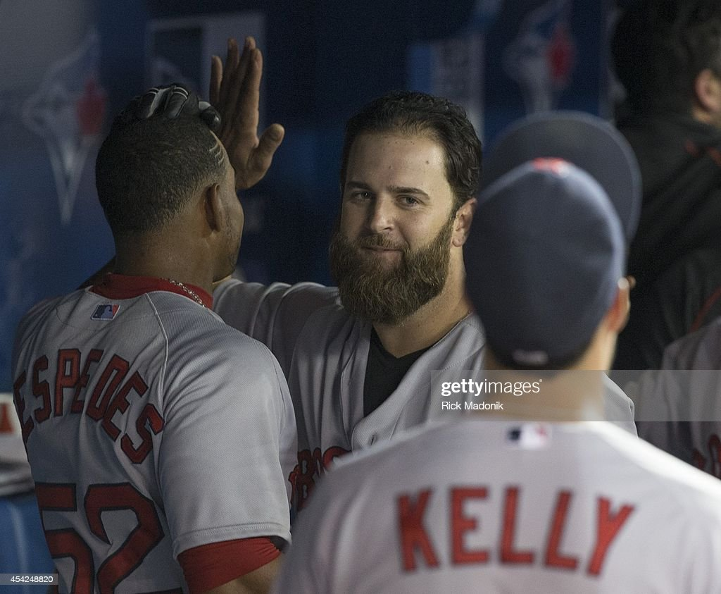 TORONTO - AUGUST 26 - BoSox slugger Mike Napoli is welcomed in the dugout after belting a 3 run homer in extra innings. Toronto Blue Jays Vs Boston Red Sox during MLB action at Rogers Centre on August 26, 2014. Jays lose 11-7 in 11 innings.