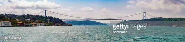 bosphrous bridge view from sea. - contemporary istanbul foto e immagini stock