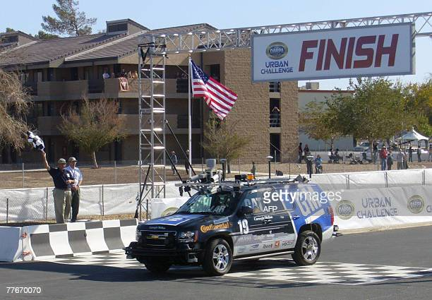 Boss a Chevrolet Tahoe SUV heavily modified and robotized by a team of Carnegie Mellon university and General Motors crosses the finish line in...