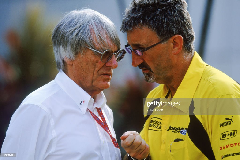 FIA boss Bernie Ecclestone chats to Jordan-Ford boss Eddie Jordan during the Malaysian Formula One Grand Prix held on March 23, 2003 at the Sepang International Circuit, in Kuala Lumpur, Malaysia.