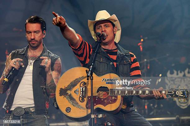 Boss Burns and Hoss Power perform at a The BossHoss concert in Max Schmeling Halle on October 24 2013 in Berlin Germany