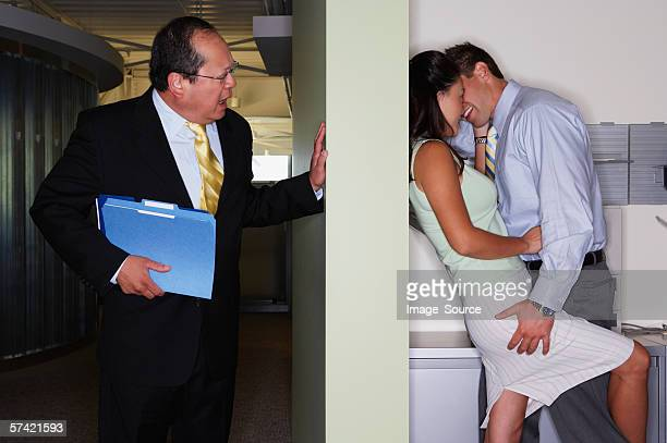 Boss catches colleagues kissing