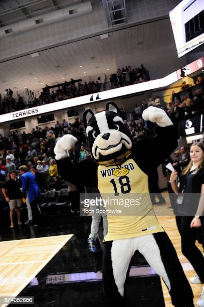 Boss Dog Wofford College Terriers mascot shows strength on the sideline during opening night at Richardson Indoor Stadium Friday November 10 in...