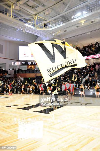 Boss Dog Wofford College Terriers mascot waves the school flag on opening night at Richardson Indoor Stadium Friday November 10 in Spartanburg South...