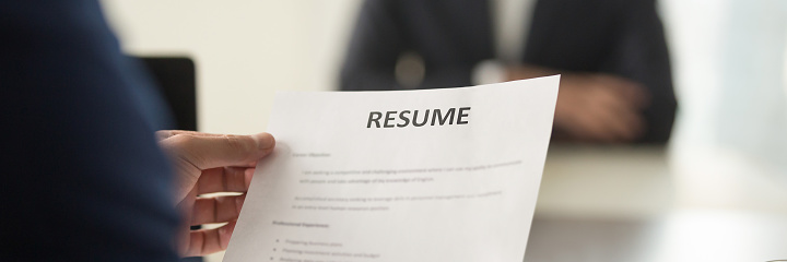 Boss holding resume cv paper interviewing vacancy candidature panoramic image 1132941031