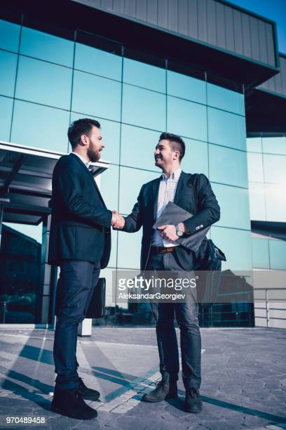 Boss Shaking Hands With Employee After A Successful Work Day