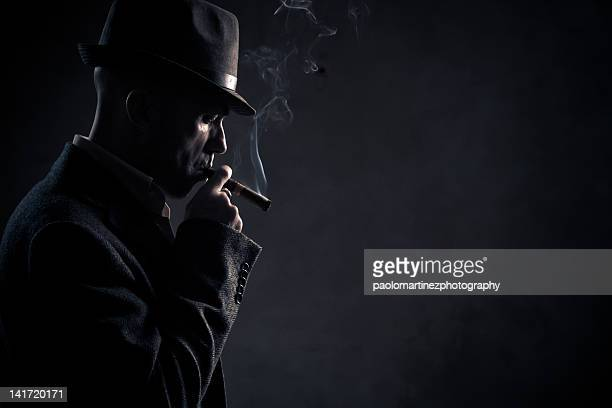 boss smoking, gangster - mafia foto e immagini stock
